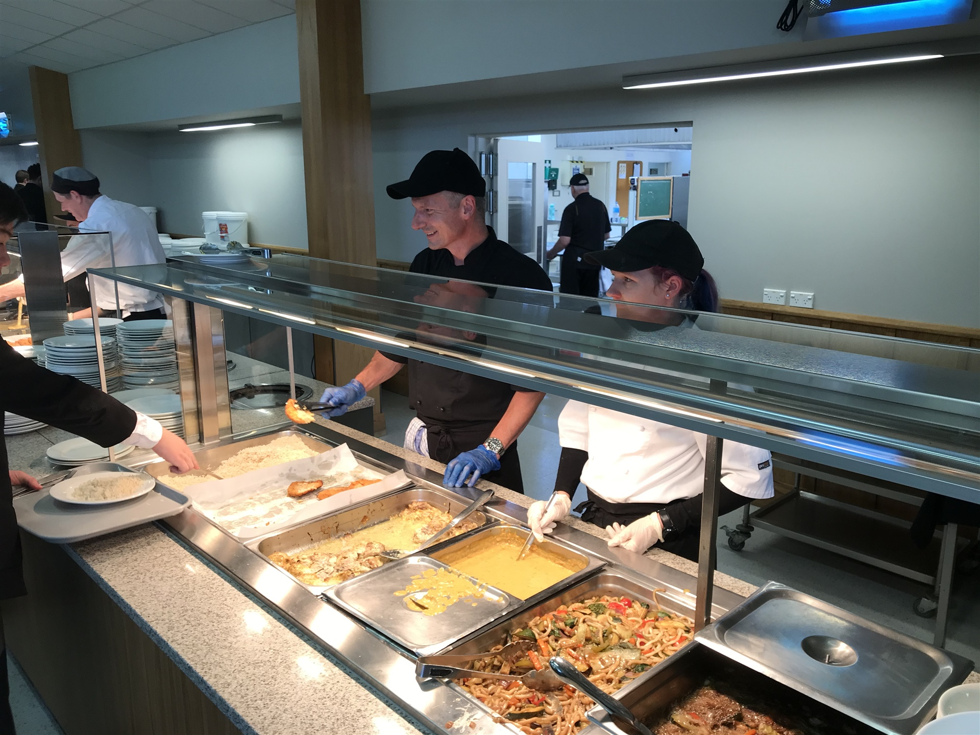 Kitchen staff and students enjoy a lasting bond